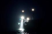 The MS Stalbas shines a search light into thick fog off the coast of Spitsbergen, Svalbard.