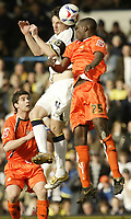 Photo: Aidan Ellis.<br /> Leeds United v Luton Town. Coca Cola Championship. 10/03/2007.<br /> Leeds Jonathon Douglas wins the header against Luton's Leon Barnett