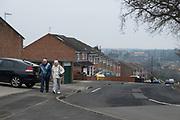 Elderly couple walking near to Bournville in Birmingham, United Kingdom.