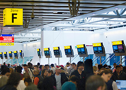 © licensed to London News Pictures. Heathrow, UK  30/06/11. Passengers waiting at Heathrow Terminal 4 on the day UK border agency staff security at Britains's biggest airport are striking alongside tens of thousands of other civil servants. Please see special instructions for usage rates. Photo credit should read LNP
