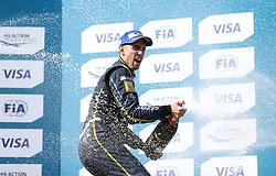E.Dams Renault driver Sebastien Buemi celebrates with the trophy after winning the Visa London ePrix at Battersea Park, London.