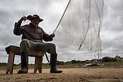 This old fisherman from a Wapishana community is preparing is own fishing net (Katoonarib, South Rupununi).