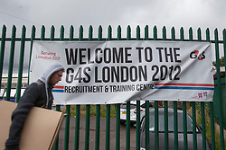 © licensed to London News Pictures. London, UK 14/07/2012. A G4S staff leaving the company's Recruitment & Training Centre in Stratford this morning . Photo credit: Tolga Akmen/LNP