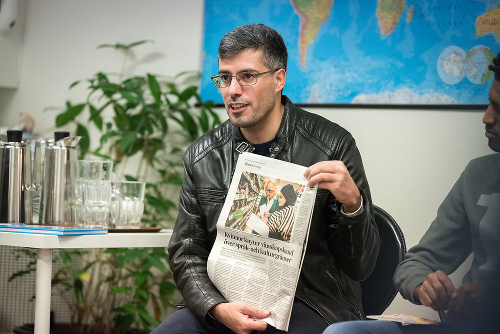 27 October 2018, Stockholm, Sweden: Saeed Alnahhal explains how he has recently had an article published in a major Swedish newspaper, featuring refugees who've received support through the Goda Grannar project. Saeed himself came to Sweden as a refugee from Syria, and has received support through the project. By profession, he is a journalist. On Saturday, participants at the 2018 Assembly of the ACT Alliance visited the Stockholm Grand Mosque and the Katarina Parish of Church of Sweden to learn about their interreligious Goda Grannar ('Good Neighbours') project, through which they offer support to refugees and newly arrived people in Sweden. (Oral consent obtained for use by Church of Sweden/ACT Alliance.)