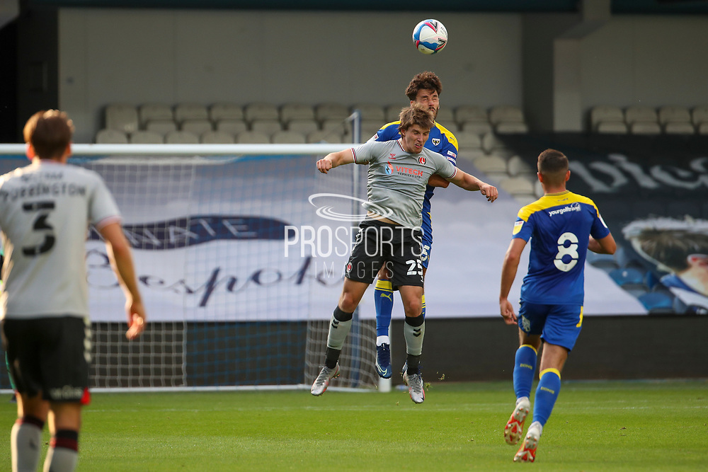 AFC Wimbledon defender Will Nightingale (5) winning header during the EFL Trophy Group O match between AFC Wimbledon and Charlton Athletic at the Kiyan Prince Foundation Stadium, London, England on 1 September 2020.