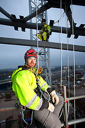 VeloPark. Portrait of rope access technicians Justin Nixon and Graham Terrell in the VeloPark. Picture taken on 19.01.2010 by David Poultney.