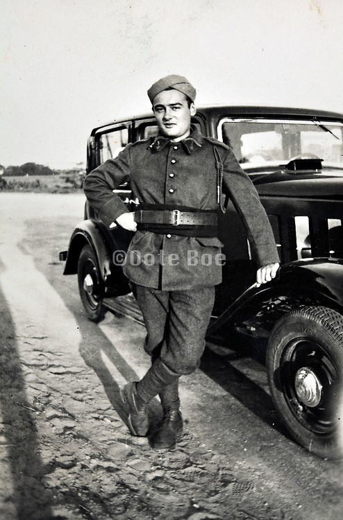 chauffeur posing with automobile 1930s