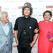 NLD/Amsterdam/20150525 - Premiere Schneider & Bax, Alex van Warmerdam (L), zoon (M) en partner Annet Malherbe (R)