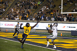 Nevada wide receiver Romeo Doubs (7) makes a touchdown reception behind California cornerback Collin Gamble (21) during the second quarter of an NCAA college football game, Saturday, Sept. 4, 2021, in Berkeley, Calif. (AP Photo/D. Ross Cameron)