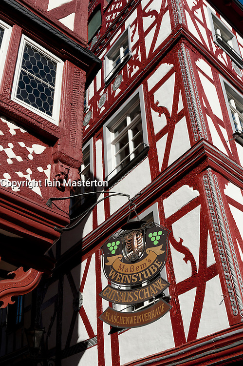Wine shop sign outside old half timbered houses in Bernkastel-Kues village on River Mosel in Mosel valley in Germany