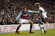 Carl Jenkinson of West Ham United is challenged by Christian Eriksen of Tottenham Hotspur ®. Barclays Premier league match, Tottenham Hotspur v West Ham Utd at White Hart Lane in London on Sunday 22nd November 2015.<br /> pic by John Patrick Fletcher, Andrew Orchard sports photography.