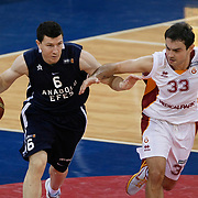 Galatasaray's Ender ARSLAN (R) and Anadolu Efes's Vlado ILIEVSKI (L) during their BEKO Basketball League derby match Galatasaray between Anadolu Efes at the Abdi Ipekci Arena in Istanbul at Turkey on Sunday, November 13 2011. Photo by TURKPIX