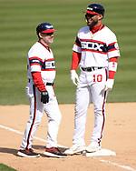 CHICAGO - APRIL 28:  Third base coach Nick Capra #12 talks to Yoan Moncada #10 of the Chicago White Sox during the game against the Detroit Tigers on April 28, 2019 at Guaranteed Rate Field in Chicago, Illinois.  (Photo by Ron Vesely)  Subject:   Nick Capra; Yoan Moncada
