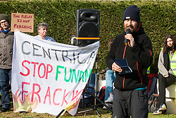 Windsor, UK. 22nd February, 2019. Hamish Haynes of the Preston New Road campaign addresses around 60 campaigners from Reclaim the Power and Fuel Poverty Action who set up a mock fracking site during a family-friendly protest outside the headquarters of Centrica to call on the British multinational energy and services company to cease its support for fracking operations through its partnership with shale gas company Cuadrilla Resources.