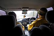 Skiers driving through sleet on the access road to ski field Turoa. Turoa is located on active volcano Mount Ruapehu, New Zealand.