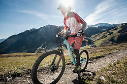 Mountain biker riding on uphill, Saalbach-Hinterglemm, Zell am See, Salzburg, Austria