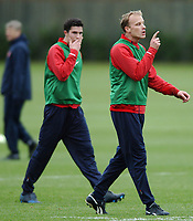 Photo: Javier Garcia/Back Page Images Mobile +447887 794393<br />Arsenal FC UEFA Champions League Training, London Colney, 06/12/04<br />Robin Van Persie looks on as fellow Dutchman Dennis Bergkamp has something to say in training