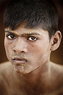 Portrait of a young Kushti wrestler taking a break from his practice, Varanasi, India