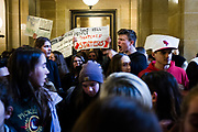 High school students gather and chant in support of stronger gun regulation and legislation outside the Governor's office inside the the State Capitol in Madison, Wisconsin, Wednesday, March 14, 2018.