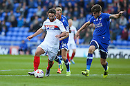 Will Grigg of Wigan Athletic tries to get away from Cameron Burgess of Oldham Athletic during the EFL Cup match between Oldham Athletic and Wigan Athletic at Boundary Park, Oldham, England on 9 August 2016. Photo by Simon Brady.