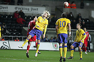Ola Toivonen of Sweden (11) wins a header. International friendly, Wales v Sweden at the Liberty Stadium in Swansea on Wed 3rd March 2010. pic  by  Andrew Orchard