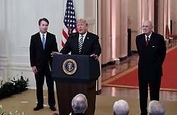 U.S. President Donald Trump, center, speaks as Brett Kavanaugh, associate justice of the U.S. Supreme Court, left, and Anthony Kennedy, former associate justice of the U.S. Supreme Court, listen during a ceremonial swearing-in event in the East Room of the White House in Washington, D.C., U.S., on Monday, Oct. 8, 2018. Photo by Olivier Douliery/ Abaca Press
