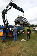 One of Matt Covey's cars is unloaded using a crane before the race meeting at Smallfield Raceway, Surrey, UK on the 10th of July 2011 (photo by Andrew Tobin/SLIK images)