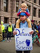 29 APRIL 2017 - MINNEAPOLIS, MINNESOTA: A man carries his son during the People's Climate Solidarity March in Minneapolis. Thousands of people marched through downtown Minneapolis and rallied around the US Federal Courthouse to participate in the People's Climate Solidarity March. The Minneapolis march coincided with other marches to protest the climate change policies of President Trump and the Republican Party that were held across the US. It took place just one week after a series of large marches in support science and fact based decision making.     PHOTO BY JACK KURTZ