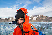 Acoustics specialist Krysztof Herman dressed in a survival suit and ready to help out with glacier field work at Samarinbreen, Hornsund, Svalbard.