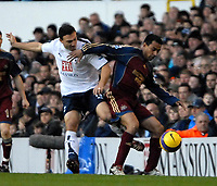 Photo: Ed Godden/Sportsbeat Images.<br /> Tottenham Hotspur v Newcastle United. The Barclays Premiership. 14/01/2007. Spurs' Steed Malbranque (L), is held off the ball by Nolberto Solano.