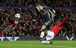 Manchester United's Romelu Lukaku beats CSKA Moscow's Viktor Vasin to score his side's first goal during the UEFA Champions League match at Old Trafford, Manchester.
