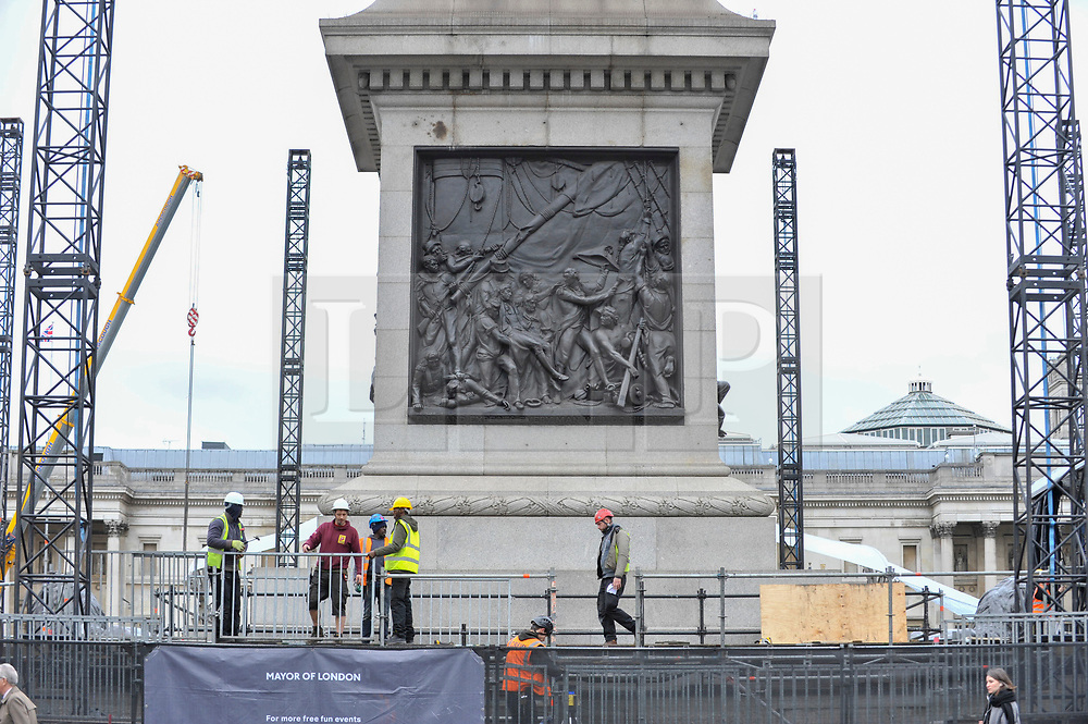 © Licensed to London News Pictures. 08/11/2017. London, UK. Construction workers in the process of building a huge stage in Trafalgar Square for rock band U2 to play a free, open air concert for 7,000 spectators on 11 November, as the MTV Europe Music Awards come to London.  Photo credit: Stephen Chung/LNP