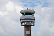 Air traffic control tower in the clouds with microwave and radio antennas - Cairns Airport, Queensland, Australia <br /> <br /> Editions:- Open Edition Print / Stock Image