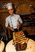 Chefs preparing barbecue meats at Rafain Churrascaria restaurant, Foz do Iguacu, Brazil.