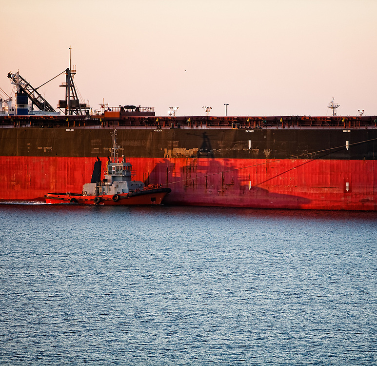 An Ore Carrier docks at Port Hedland to be loaded with iron ore for export.