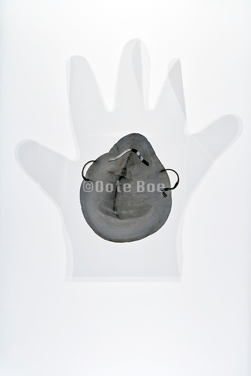 transparent gloves with dirty paper mask