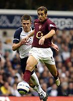 Photo: Chris Ratcliffe.<br />Tottenham Hotspur v Arsenal. The Barclays Premiership.<br />29/10/2005.<br />Matthieu Flamini of Arsenal gets away from Michael Carrick.
