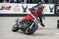 Hooligan Danny Holbus on his 1996 Harley-Davidson Sportster races into turn one at the Flat Out Friday flat track racing on the Dr. Pepper-covered track in the UW-Milwaukee Panther Arena during the Harley-Davidson 115th Anniversary Celebration event. Milwaukee, WI. USA. Friday August 31, 2018. Photography ©2018 Michael Lichter.