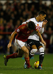 Eric Lichaj of Nottingham Forest (L) and Thomas Ince of Derby County in action - Mandatory byline: Jack Phillips / JMP - 07966386802 - 6/11/2015 - FOOTBALL - The City Ground - Nottingham, Nottinghamshire - Nottingham Forest v Derby County - Sky Bet Championship
