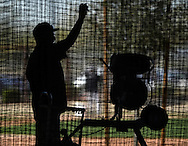 GLENDALE, AZ - FEBRUARY 25:  Coach Bryan Little of Chicago White Sox works the pitching machine during spring training workouts on February 25, 2015 at The Ballpark at Camelback Ranch in Glendale, Arizona. (Photo by Ron Vesely)   Subject:   Bryan Little