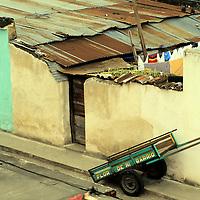 "Central America, Guatemala, Antigua. An empty cart has seen better days carrying ""Flor de mi barrio"" or ""flower of my neighborhood"" in Antigua, Guatemala."