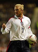 Photograph: Scott Heavey.<br />England v Denmark. International Friendly. 16/11/2003.<br />David Beckham signals to the Danish defence