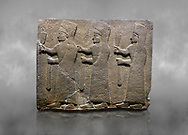 Hittite monumental relief sculpted orthostat stone panel of a Procession. Basalt, Karkamıs, (Kargamıs), Carchemish (Karkemish), 900-700 B.C.  Marching female figures. Anatolian Civilisations Museum, Ankara, Turkey.<br /> <br /> It is a depiction of three marching female figures in long dress with a high headdress at their head. These women are considered to be the nuns of the Goddess Kubaba. They have a bunch of Spica in their right hand, and objects similar to a sceptre in their left hand. .<br />  <br /> If you prefer to buy from our ALAMY STOCK LIBRARY page at https://www.alamy.com/portfolio/paul-williams-funkystock/hittite-art-antiquities.html  - Type  Karkamıs in LOWER SEARCH WITHIN GALLERY box. Refine search by adding background colour, place, museum etc.<br /> <br /> Visit our HITTITE PHOTO COLLECTIONS for more photos to download or buy as wall art prints https://funkystock.photoshelter.com/gallery-collection/The-Hittites-Art-Artefacts-Antiquities-Historic-Sites-Pictures-Images-of/C0000NUBSMhSc3Oo