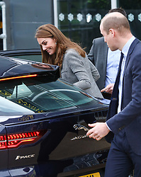 © Licensed to London News Pictures. 12/11/2019. London, UK. Duke and Duchess of Cambridge leave the Troubadour Theatre with a bouquet of flowers. The Duke and Duchess of Cambridge attend Shout's Crisis Volunteer celebration event at the Troubadour Theatre, White City, London. The event brings together people from across the UK who volunteer around the clock with Shout to support people in crisis.. Photo credit: Alex Lentati/LNP