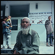 People wait outside a hospital in Jalalabad.