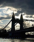PUTNEY, LONDON, ENGLAND, 05.03.2006,USA crew pass under Hammersmith bridge after taking clear water from OUBC. Pre 2006 Boat Race Fixtures,.   © Peter Spurrier/Intersport-images.com. Varsity Boat Race, Rowing Course: River Thames, Championship course, Putney to Mortlake 4.25 Miles Sunrise, Sunsets, Silhouettes