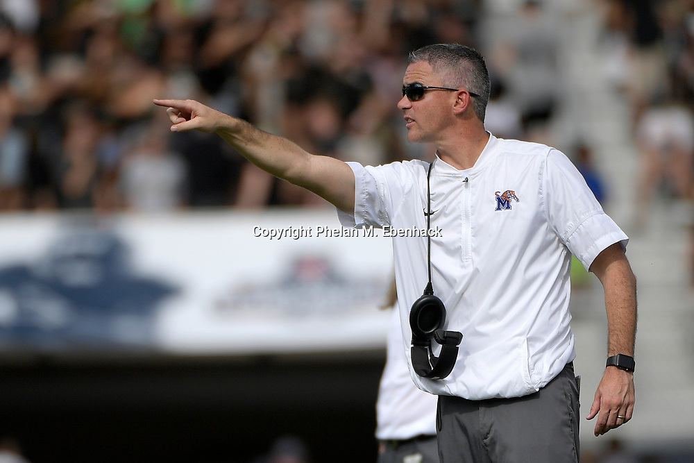Memphis head coach Mike Norvell calls out to his team during the first half of the American Athletic Conference championship NCAA college football game against Central Florida Saturday, Dec. 2, 2017, in Orlando, Fla. (Photo by Phelan M. Ebenhack)