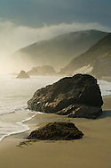 Fog shrouded hills and cliffs at sunset along Pfeiffer Beach, Big Sur Coast, Monterey County, California