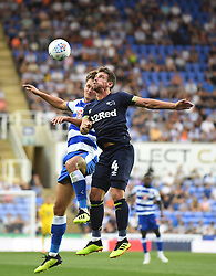 Derby County's Craig Bryson  (right) and Reading's John Swift (left)