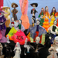 Latin America, Mexico. Skeletal Catrinas, figures celebrating Dia de Los Muertos.